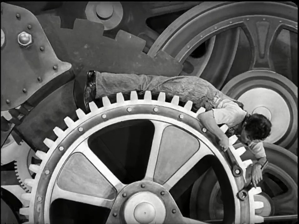 In this iconic scene from the film, Charlie Chaplin literally becomes a cog in the machine.